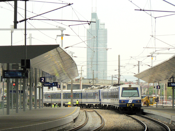 The city railway arrives in the station Praterstern, in the background is the Millennium Tower